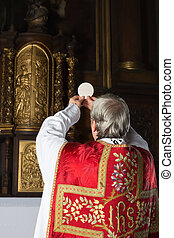 Vintage catholic mass - Consecration during an old-fashioned...