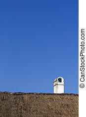 vintage chimney on rooftop