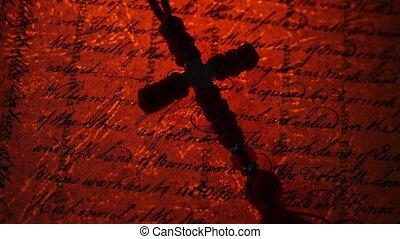 Vintage christian cross on old manuscript