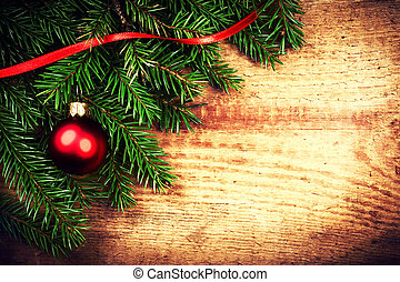 Vintage Christmas Background with Tree Branch on wooden backgrou