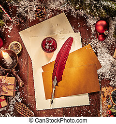 Vintage Christmas flat lay with paper and quill