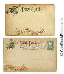 Two aging Christmas time postcards from 1910, isolated on white. Both are blank and have clipping paths.