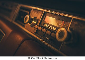 Vintage Classic Car Radio in the Vehicle Dashboard. 80s...