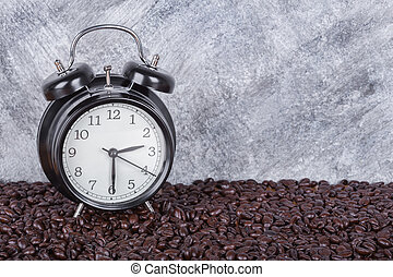 vintage clock and coffee beans (Coffee time concept) with wall background