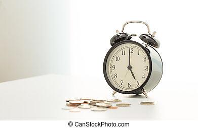 Vintage clock at 5 o'clock and coins