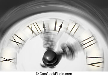 Vintage clock blurred - conceptual image of time running or passing away