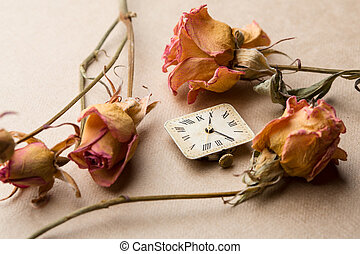Vintage clock dial with dry roses
