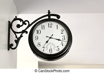 vintage clock hanging on wall