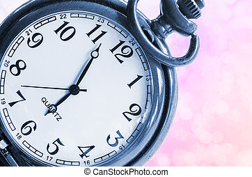 Vintage clock on beautiful pink background.