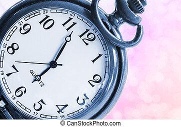 Vintage clock on beautiful pink background.