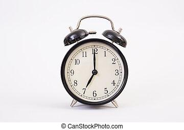 Vintage clock on white background