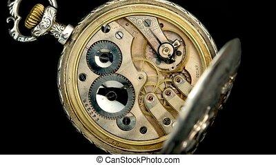 Vintage clock rotating mechanism. Close up. Time lapse . Back background