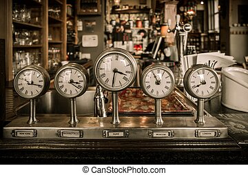 Vintage clocks on a bar counter in a pub