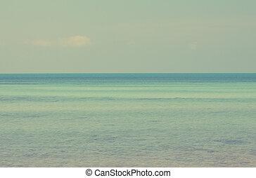 Vintage cloud sky and seascape,filtered image