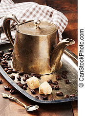 Vintage coffee pot on silver tray