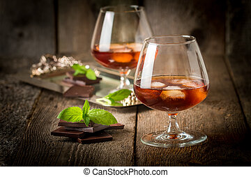 Vintage cognac still life with chocolate