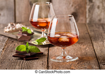 Vintage cognac still life with chocolate