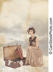 vintage collage with beautiful brunette girl in clouds