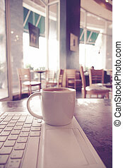 vintage color tone of cup of coffee on the table coffee shop...