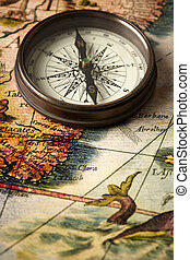 vintage compass on a map - selective focus on arrow, photo...