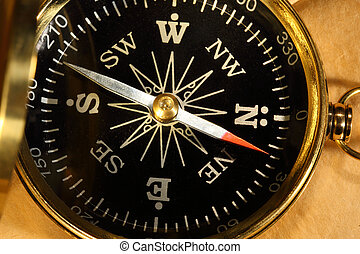 Vintage compass on blank yellowed paper