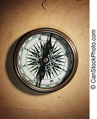 Vintage compass on old paper