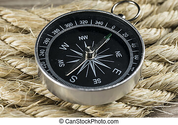 Vintage compass on rope