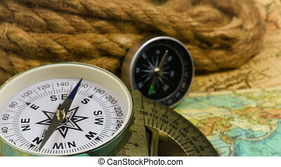 Vintage compass with rope - Vintage compass with a rope on...