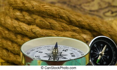 Vintage compass with rope - Vintage compass with a rope on...
