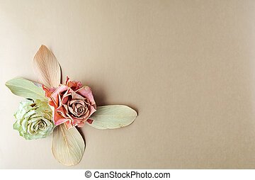 Vintage composition dry bouquet with roses on gold background. Backdrop useful for wedding cards and other holiday decoration. Flat lay. Top view
