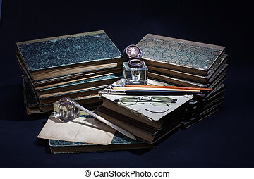 Vintage concept with old books, papers, ink pen and inkpot