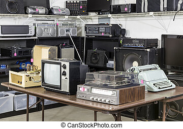 Vintage consumer electronics inside a funky thrift antique store