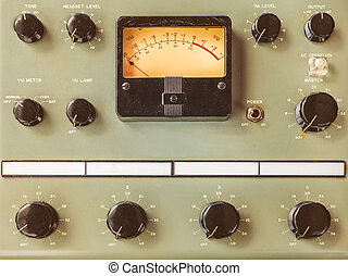 Vintage control panel with volt meter and black round knobs