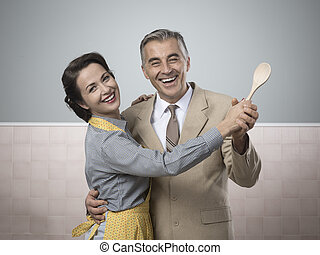 Vintage couple dancing in the kitchen - Smiling vintage ...