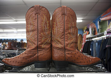 Vintage cowboy boots in a thrift store