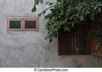 vintage cracked wall with a window