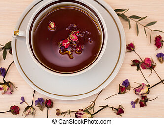 Vintage cup of tea with buds of roses