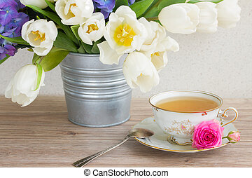vintage cup of tea with tulips