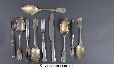 Vintage cutlery on a black background. Top view. Concept for...