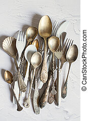 Vintage cutlery on a white background. Silver and cupronickel spoons, forks and knives.