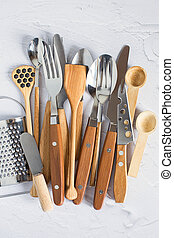 Vintage cutlery on a white background. Silver spoons, forks, table knives with wooden handles