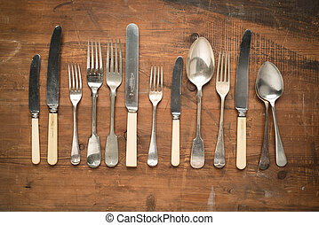 Vintage cutlery on wooden background
