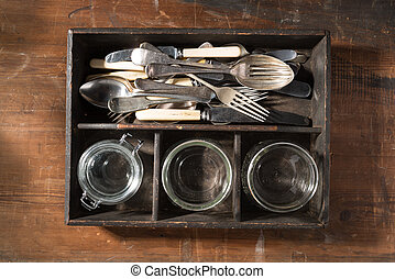 Vintage cutlery tray on wooden background
