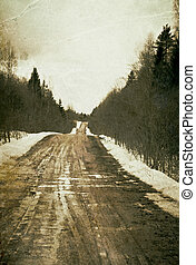 Vintage depressed and deserted village road. Grunge background.