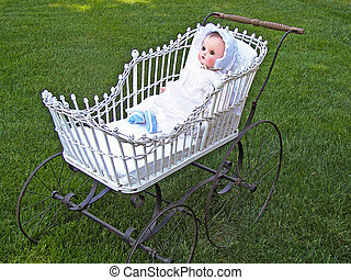 Vintage doll in buggy