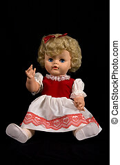 Vintage toy doll on isolated background