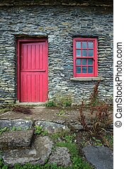 Vintage door and window on a facade of an old cottage in Ireland