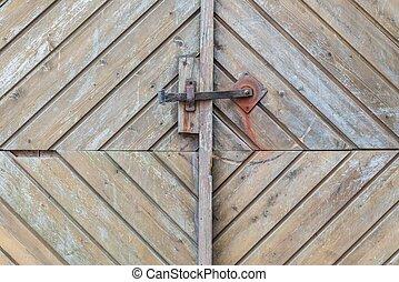 Vintage door handle on a wooden front door, Germany