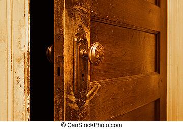 Vintage door knob - a close up of a vintage door that is...
