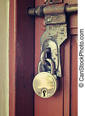 Vintage door lock on wooden door, close up